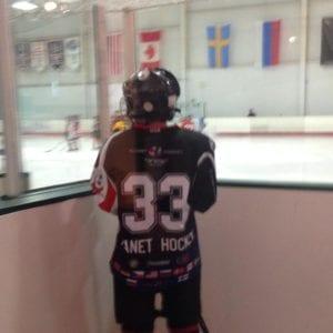 Alex playing ice hockey